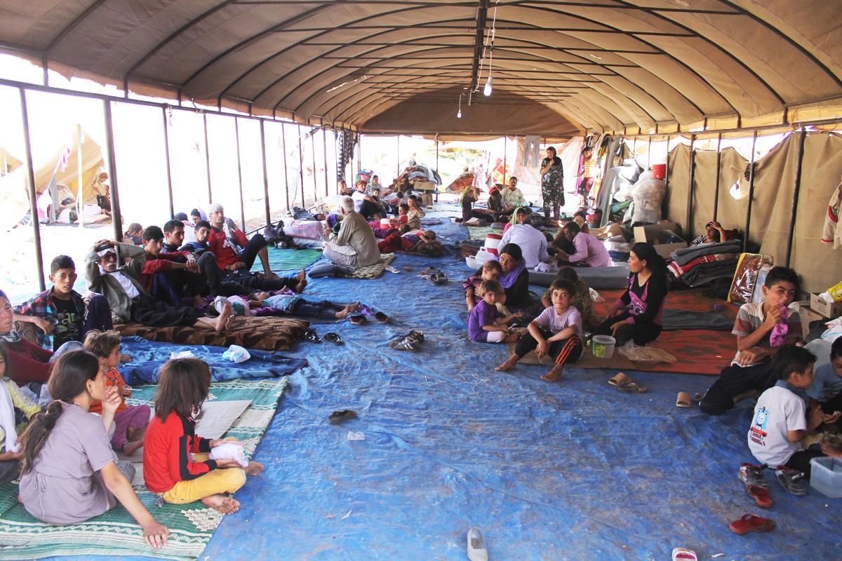 Flüchtlinge aus dem Irak warten darauf, dass sie in ihr Heimatland zurückkehren können. (Foto: DFID – Rachel Unkovic (CC BY 2.0) / Wikimedia Commons)